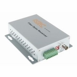 1-ch point-to-point simplex video with up-the-coax telemetry transmitter, 2-ch duplex contact closures, 1 fiber, 1310/1550 nm single-mode, 15 dB optical loss budget, ~30km range. Desktop unit, ST connector, US power plug.